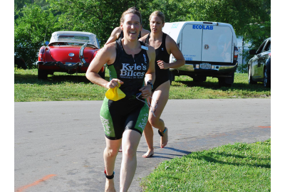 Shawn Blaesing-Thompson exits the water with a smile at the 2014 Iowa Games Triathlon