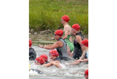 """Katherine wore her """"Kyle's Bike's/Discount Tri Supply green"""" swimsuit for the 2013 Cyman Triathlon"""
